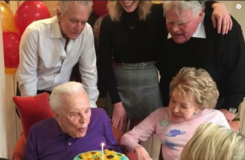 Kirk Douglas on his 101'th Birthday with family members around him  (photo credit: YOUTUBE SCREENSHOT)