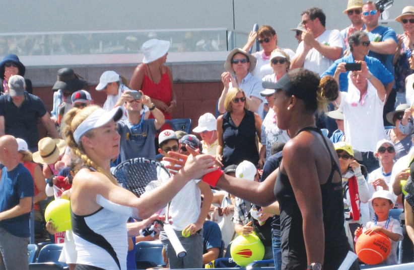 ISRAEL'S JULIA GLUSHKO (left) shakes hands at the net with Japan's Naomi Osaka after the latter defeated Glushko 6-2, 6-0 last night in the second round of the US Open.  (photo credit: HOWARD BLAS)