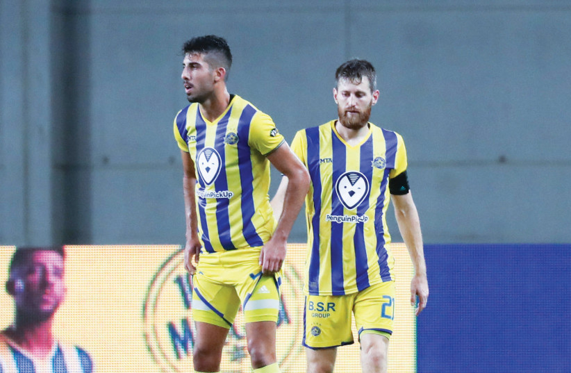 DESPITE A 2-1 home victory last night over Sarpsborg 08, a late penalty goal saw Maccabi Tel Aviv eliminated from the Europa League with a 4-3 aggregate loss to the Norwegian side. (photo credit: DANNY MARON)