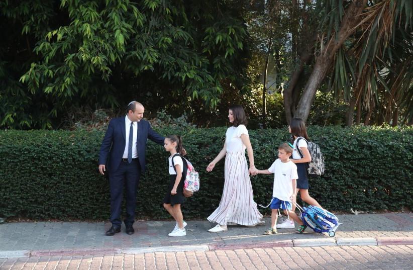 Education Minister Naftali Bennett takes his family to school, Septemer 2, 2018 (photo credit: ODED KARNI/GPO)