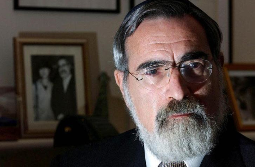 Britain's Chief Rabbi Dr Jonathan Sacks speaks during an interview at his home in London, April 17, 2002 (photo credit: REUTERS)