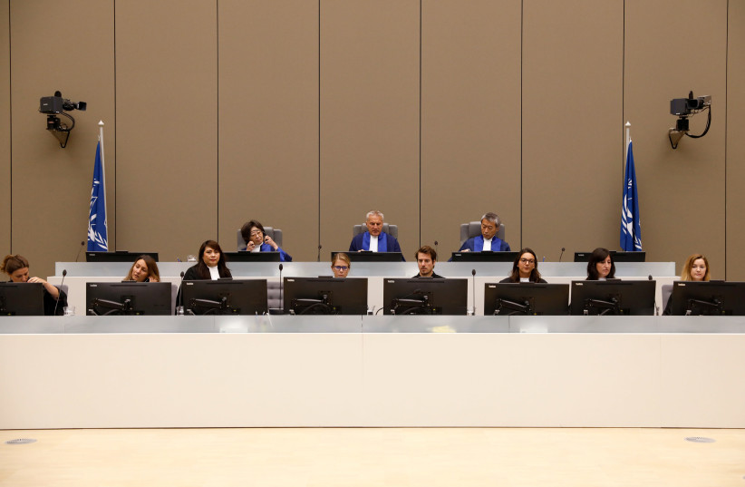 Presiding Judge Robert Fremr in the courtroom at the ICC (International Criminal Court) in the Hague, the Netherlands, 2018 (photo credit: BAS CZERWINSKI/POOL VIA REUTERS)