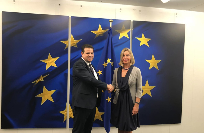 Ayman Odeh shakes hands with Federica Mogherini in Brussles, September 4, 2019 (photo credit: JOINT LIST)