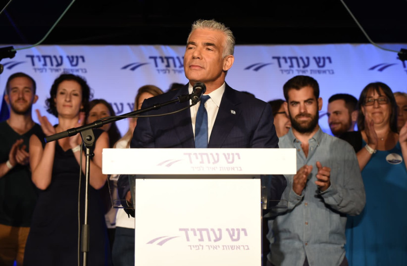 Yesh Atid leader Yair Lapid at a pre-Rosh Hashana toast for his party's activists in Tel Aviv (photo credit: ELAD GUTMAN)