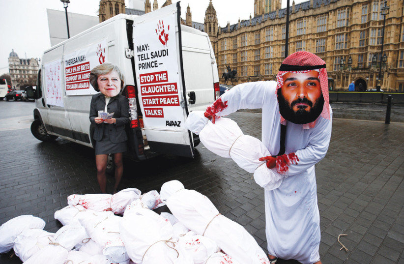ACTIVISTS STAGE a protest timed to coincide with the visit by Saudi Crown Prince Mohammad bin Salman, also mocking British Prime Minister Theresa May, outside Parliament in London on March 7. (photo credit: REUTERS)
