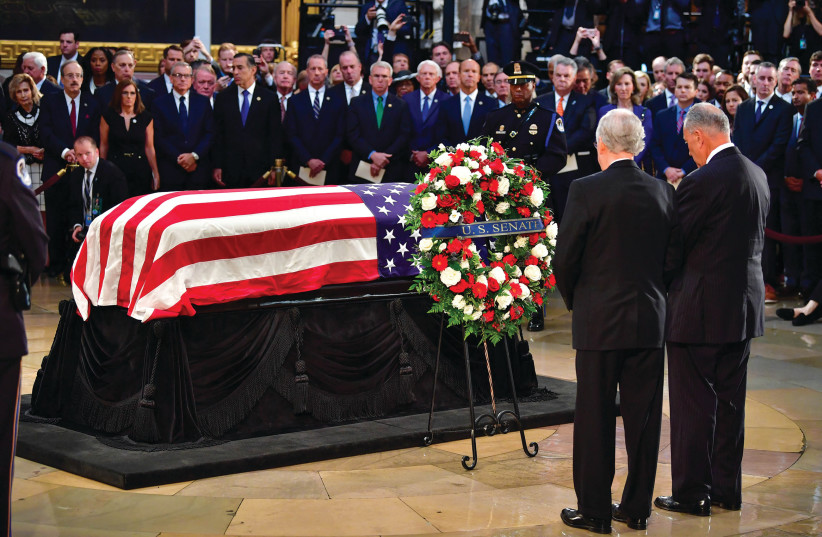 JOHN MCCAIN'S casket rests in front of mourners (photo credit: REUTERS)