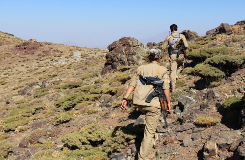 KURDISH MEMBERS of the Democratic Party of Iranian Kurdistan hike through the mountains from Iraq to Iran. (photo credit: COURTESY ZACH HUFF)