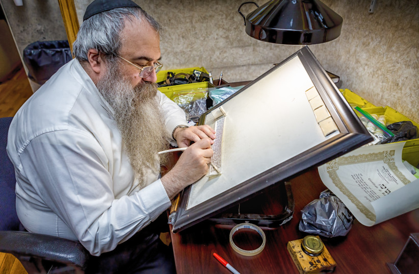 Rabbi Faitel Lewin busy at work.  (photo credit: CHABAD.ORG/ ELIYAHU PARYPA)
