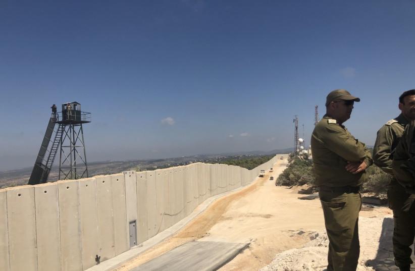 IDF officers stand near Israel's newly built wall on the Lebanon border (photo credit: ANNA AHRONHEIM)