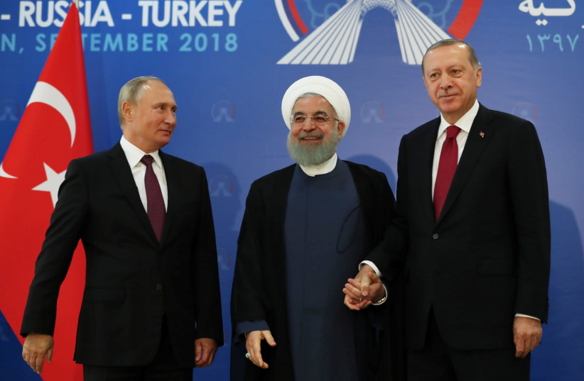 President Vladimir Putin of Russia, Hassan Rouhani of Iran and Tayyip Erdogan of Turkey meet in Tehran, Iran September 7, 2018. (photo credit: REUTERS)