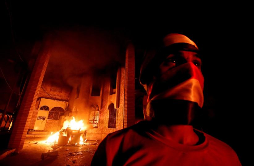 Iraqi protesters burn the Iranian Consulate in Basra, Iraq September 7, 2018. (photo credit: ESSAM AL-SUDANI/ REUTERS)
