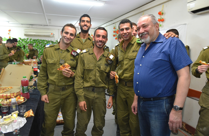 Defense Minister Avigdor Liberman with soldiers from the 7th Armored Brigade  (photo credit: ARIEL HERMONI / DEFENSE MINISTRY)