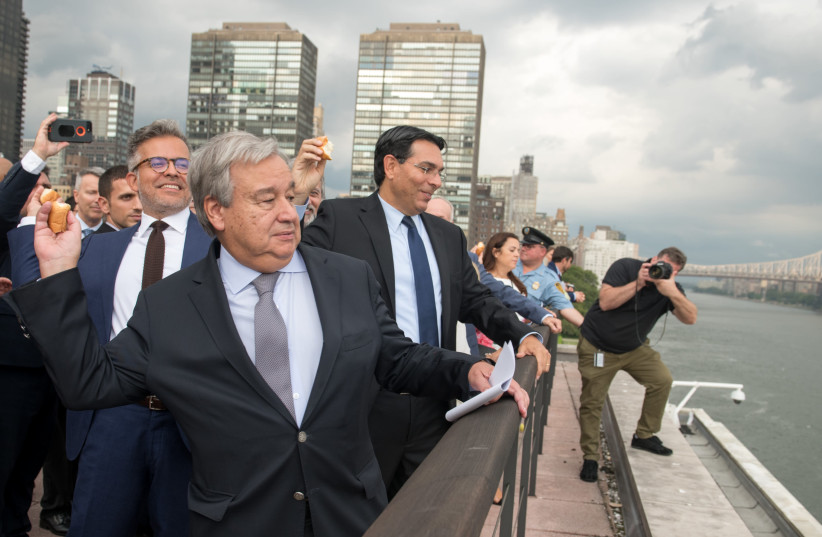 Secretary-General of the UN António Guterres [L] and Israel's Permanent Representative to the UN Danny Danon [R] during the UN Tashlikh  (photo credit: NIR ARIELI)