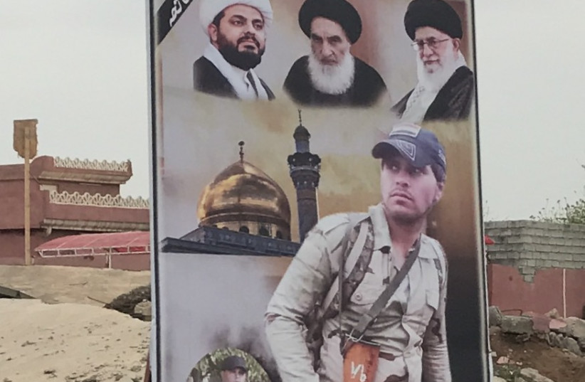 A poster for an Iranian-backed Shia militia in Iraq, one of many the US sees as proxies is Tehran. (photo credit: SETH J. FRANTZMAN)