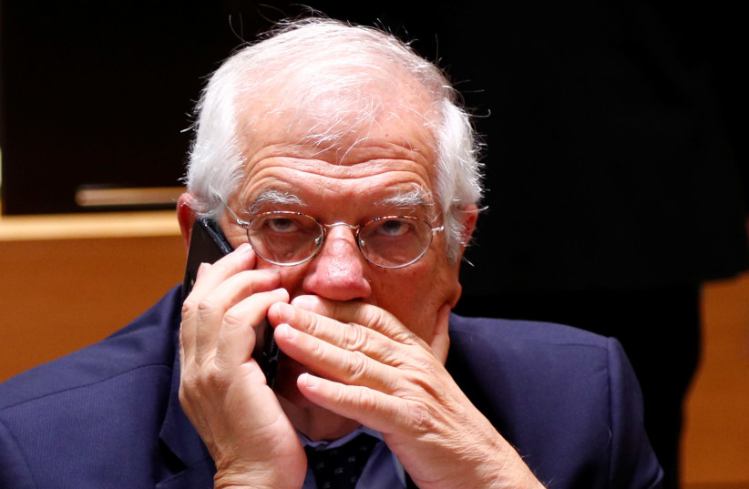 Spain's Foreign Minister Josep Borrell speaks on his mobile phone at the start of a European Union foreign ministers meeting in Brussels, Belgium July 16, 2018 (photo credit: REUTERS/FRANCOIS LENOIR)