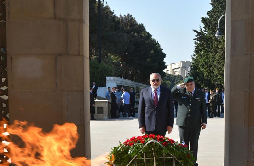 Avigdor Liberman on a visit to Azerbaijan, visiting the Eternal Fire memorial in Baku (photo credit: ARIEL HERMONI / DEFENSE MINISTRY)