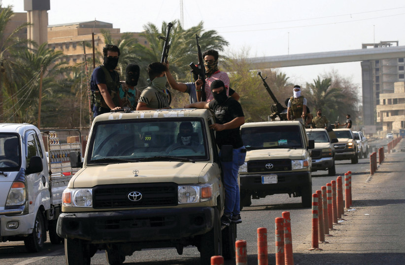VEHICLES OF Iraq's Popular Mobilization Forces patrol the streets of Basra last week.  (photo credit: REUTERS)