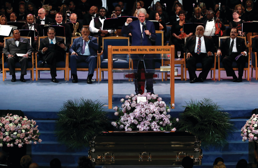 WHY WAS Bill Clinton on the same stage of Louis Farrakhan. (photo credit: REUTERS)