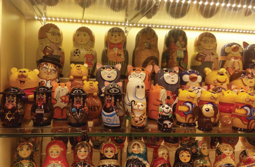 A store in Moscow's Arbat pedestrian mall displays traditional Russian babushka dolls, including some on Jewish themes.  (photo credit: LIAT COLLINS)