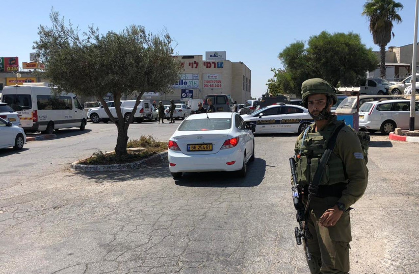 The scene of the fatal stabbing attack at the Gush Etzion Junction on September 16, 2018. (photo credit: AMICHAI GABBAI/TPS)