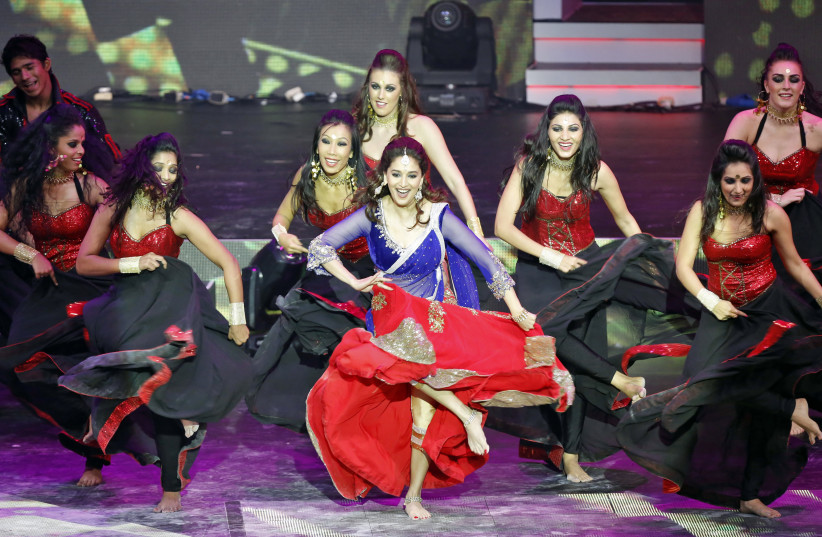 Bollywood actress Madhuri Dixit (C) performs at the 14th annual International Indian Film Academy (IIFA) awards show in Macau July 6, 2013 (photo credit: REUTERS/TYRONE SIU)