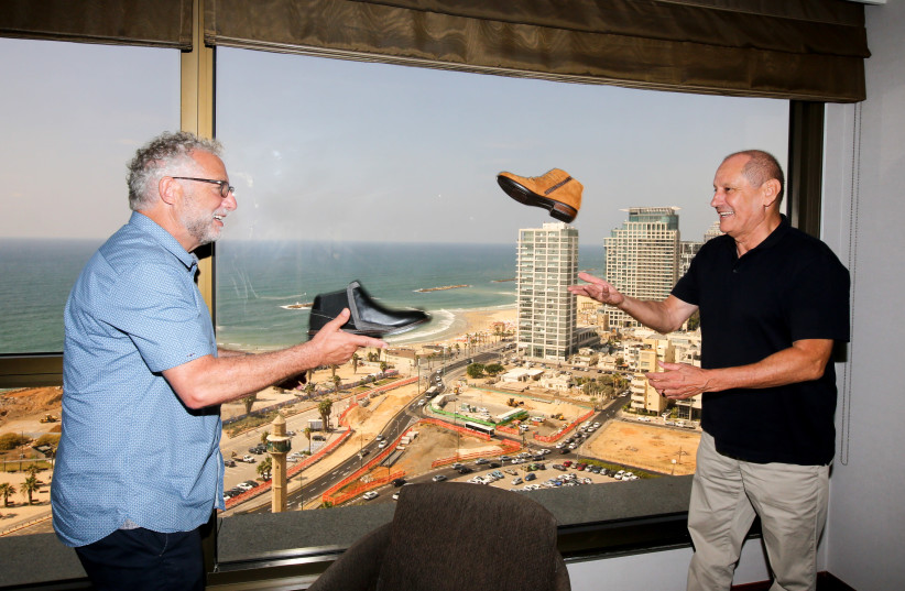 TEVA NAOT owner Steve Lax (right) and Teva manager Michael Illouz 'play catch' with Naot shoes in Tel Aviv (photo credit: MARC ISRAEL SELLEM/THE JERUSALEM POST)