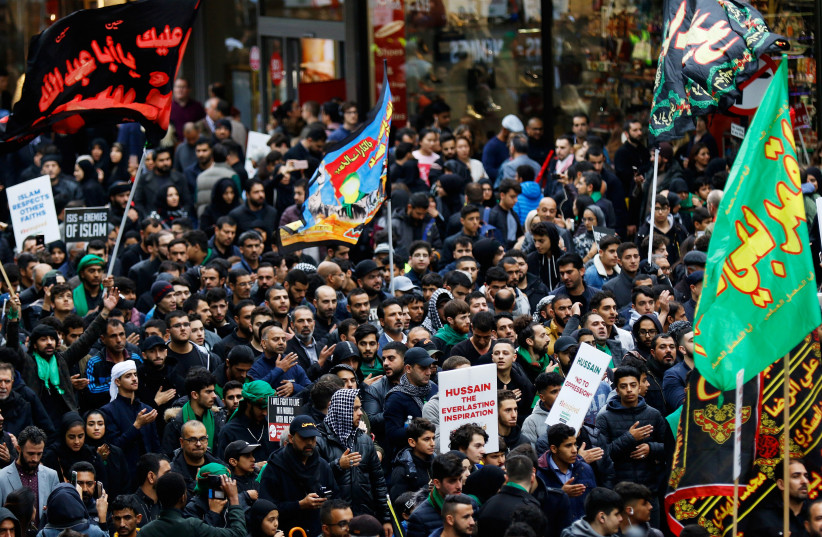 Demonstrators walk along Regent Street during an anti-ISIS, Ashura, protest march, in central London, Britain October 1, 2017 (photo credit: TOM JACOBS/REUTERS)