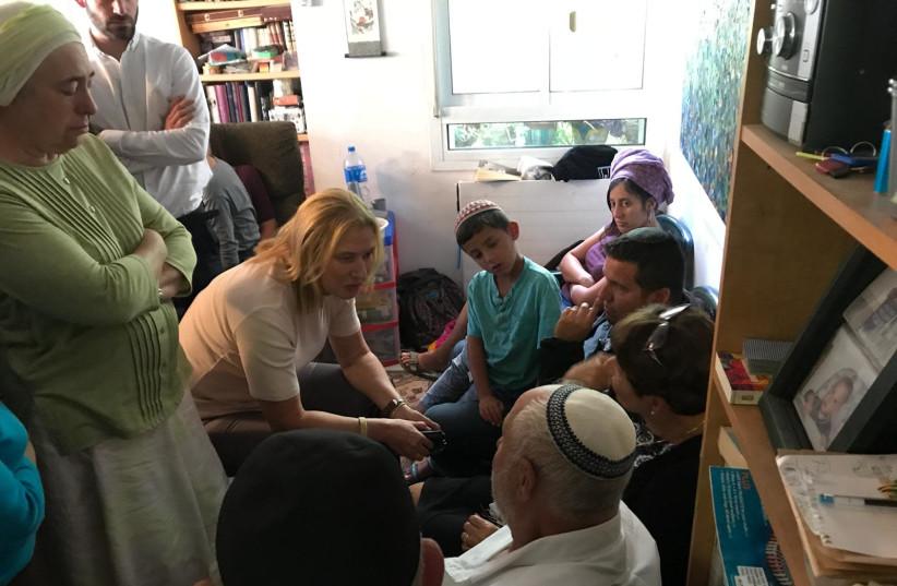 Opposition leader Tzipi Livni comforting the family of terror victim Ari Fuld in Efrat on Monday, September 17, 2018. (photo credit: ARIK BENDER/MAARIV)