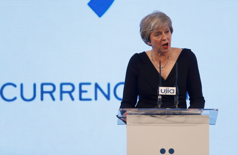 Britain's Prime Minister Theresa May speaks at the United Jewish Israel Appeal charity dinner in London (photo credit: PETER NICHOLLS/REUTERS)