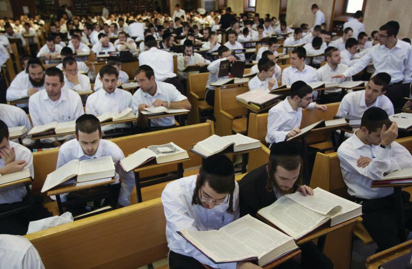 Jewish men study in a yeshiva. (photo credit: RONEN ZVULUN/REUTERS)