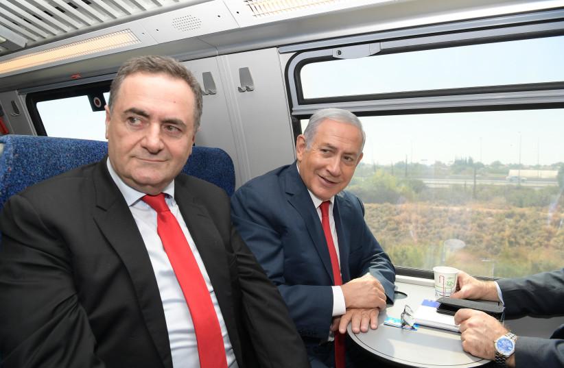Prime Minister Benjamin Netanyahu and Transportation Minister Israel Katz on inaugural ride of Jerusalem-Tel Aviv high speed rail, September 20, 2018 (photo credit: GPO)