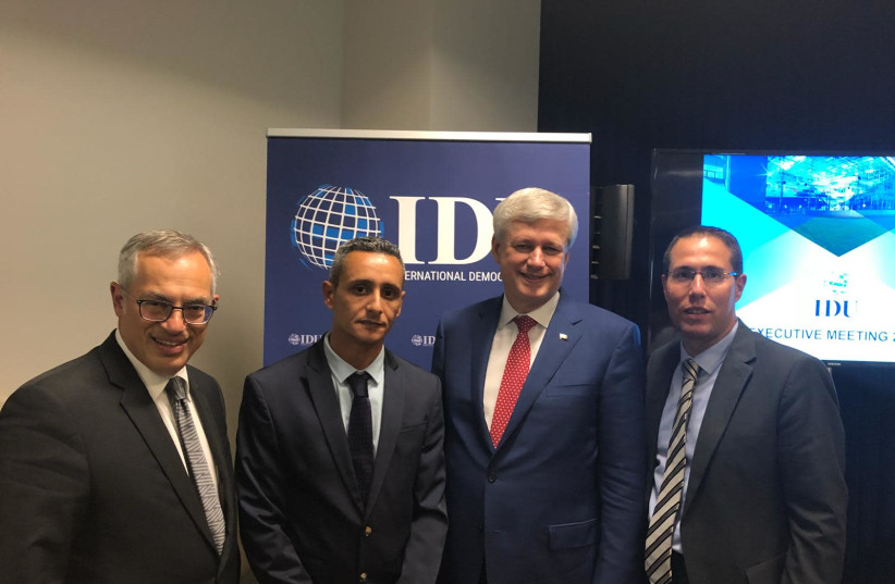From Left: Canadian MP Tony Clement, Likud director-general Tzuri Sisso, IDU chairman and former Canadian prime minister Stephen Harper, and Likud foreign affairs director Eli Hazan (photo credit: Courtesy)