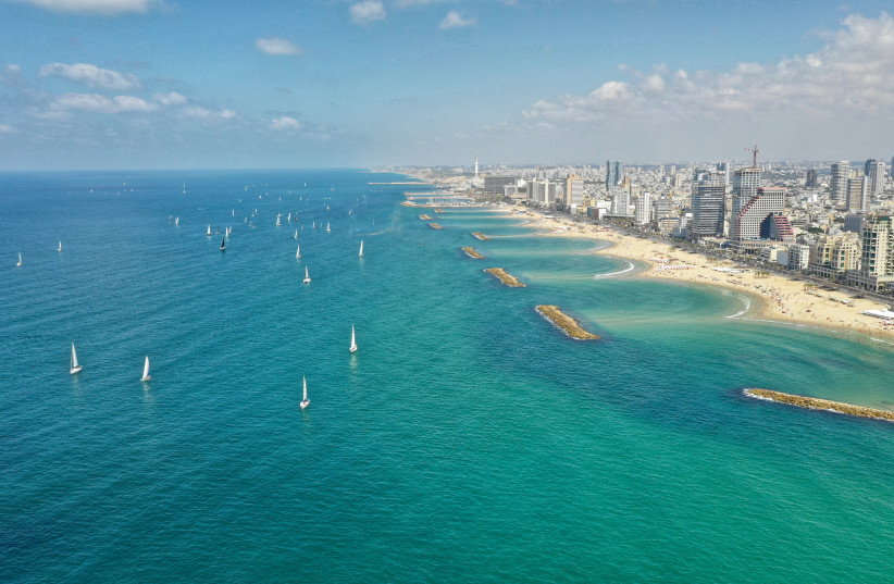 The traditional sail-by of the Sail Tel Aviv - Yaffo watersports festival which aims to promote marine activities along the 14km shoreline of the city, September 22, 2018 (photo credit: DORON SAHAR)
