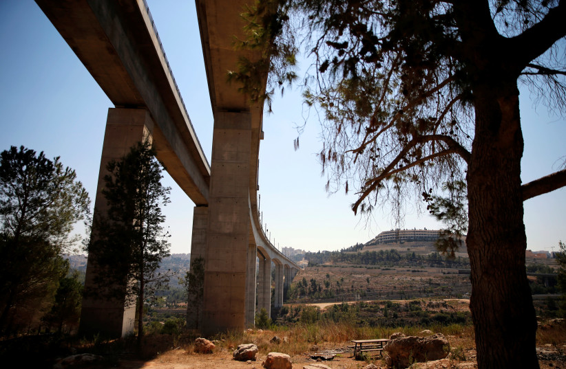 A bridge, part of the tracks of Israel's new high-speed rail line between Jerusalem and Tel Aviv, is seen in the outskirts of Jerusalem (September 23, 2018) (photo credit: REUTERS/AMMAR AWAD)