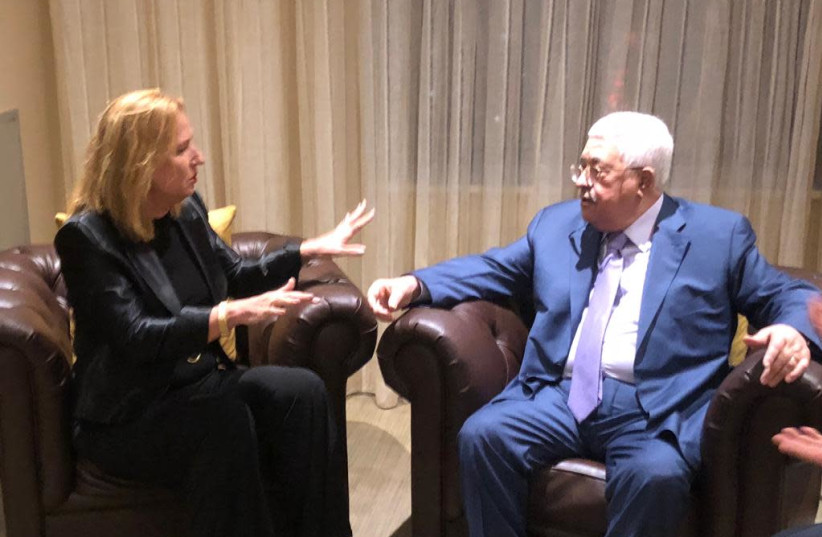 Tzipi Livni speaks with Mahmoud Abbas in New York City in a picture released Wednesday, September 26, 2018 (photo credit: Courtesy)