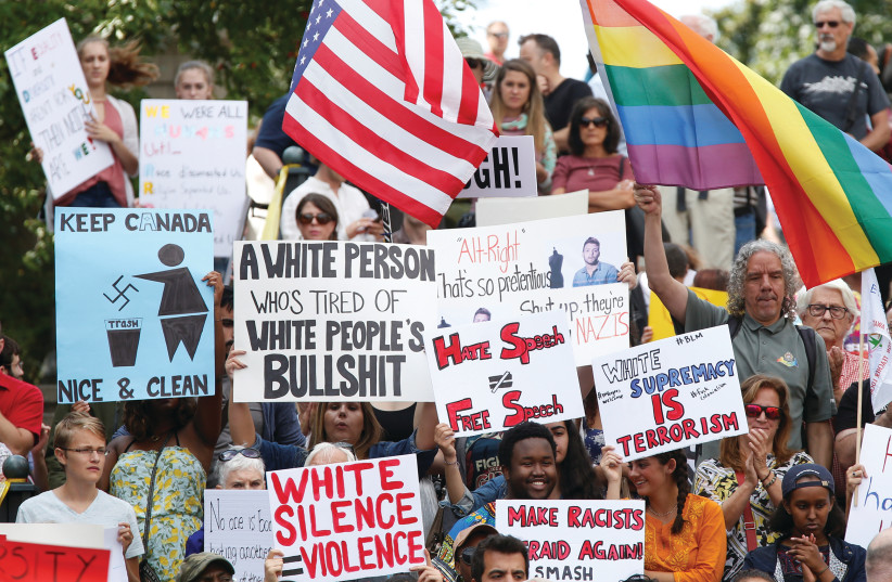 People protesting against racism (photo credit: REUTERS)