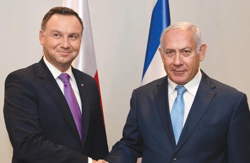 Polish President Andrzej Duda and Prime Minister Benjamin Netanyahu meet in New York on September 26, 2018. (photo credit: AVI OHAYON - GPO)