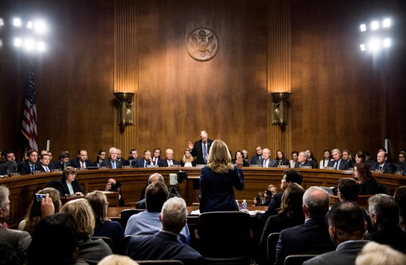 Professor Christine Blasey Ford, who accused U.S. Supreme Court nominee Brett Kavanaugh of a sexual assault in 1982, is sworn in to testify before a Senate Judiciary Committee confirmation hearing for Kavanaugh on Capitol Hill in Washington, US, September 27, 2018 (photo credit: TOM WILLIAMS/POOL VIA REUTERS)