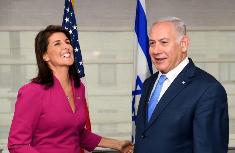 Prime Minister Benjamin Netanyahu with U.S. Ambassador to the U.N. Nikki Haley   (photo credit: AVI OHAYON - GPO)