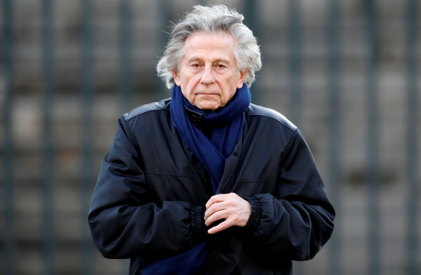 Film director Roman Polanski, Madeleine Church for 'popular tribute' to late French singer and actor Johnny Hallyday in Paris, 2017.  (photo credit: CHARLES PLATIAU / REUTERS)