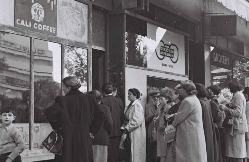 RESIDENTS OF Tel Aviv stand in line to purchase food rations against special coupons, 1954. (photo credit: HANS PINN)