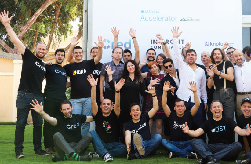 PARTICIPANTS IN the Barclays and Techstars hi-tech accelerator program show their enthusiasm; managing director Hilla Ovil Brenner is in the middle. (photo credit: Courtesy)
