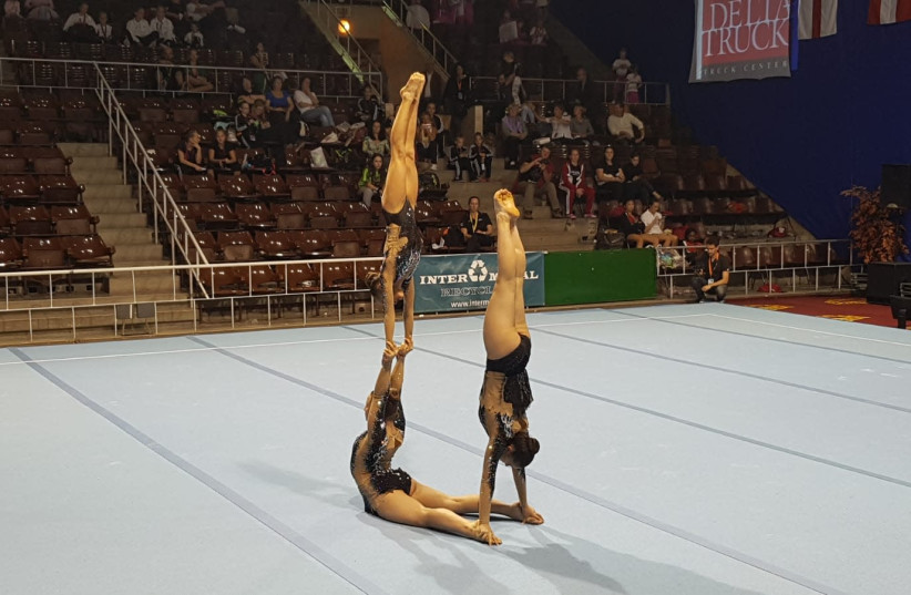 The winning exercise of the Israeli acrobatic trio that won in the Budapest Acro Cup, 2018 (photo credit: PUBLIC RELATIONS GAL COMMUNICATIONS)