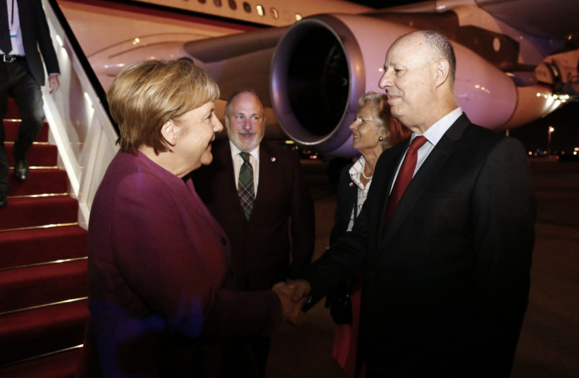 German Chancellor Angela Merkel greeted by Regional Cooperation Minister Tzachi Hanegbi at the airport, October 3rd, 2018 (photo credit: AVI DODI/FOREIGN MINISTRY)