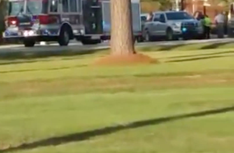 Emergency personnel are seen on site in the aftermath of a shooting in Florence, South Carolina, U.S. October 3, 2018, in this still image obtained from a social media video. (photo credit: DEREK LOWE/REUTERS)