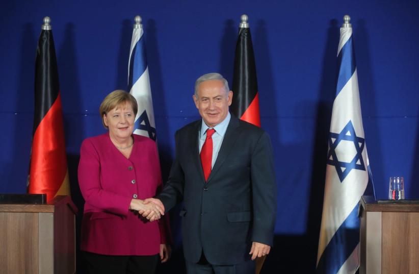 Prime Minister Benjamin Netanyahu (R) and German Chancellor Angela Merkel (L) during a press conference, October 4, 2018 (photo credit: MARC ISRAEL SELLEM/THE JERUSALEM POST)