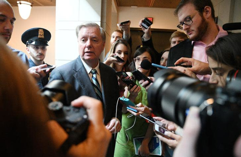 US Senator Lindsey Graham (R-SC) speaks to reporters about the FBI's investigation of sexual assault allegations surrounding U.S. Supreme Court nominee Brett Kavanaugh on Capitol Hill in Washington, US, October 4, 2018 (photo credit: MARY F. CALVERT / REUTERS)