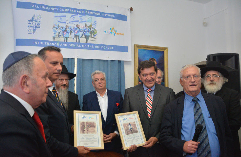 Left to right: Deputy Chair of March of the Living Aaron Tamir, Sighet Chief of Police, Chief Rabbi of Russia Berel Lazar, President of Limmud FSU Aaron G. Frenkel, Sighet Mayor Horia Vassily Scubli, Co-founder of Limmud FSU Chaim Chesler, and Chief Rabbi of Romania Rafael Schaeffer (photo credit: SAMUEL THROPE)