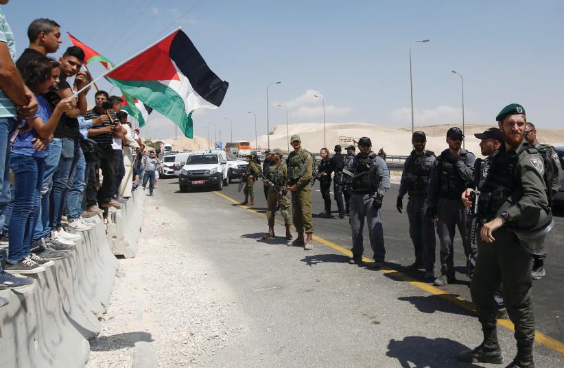 PALESTINIANS PROTESTING at Khan Al-Ahmar (photo credit: REUTERS)