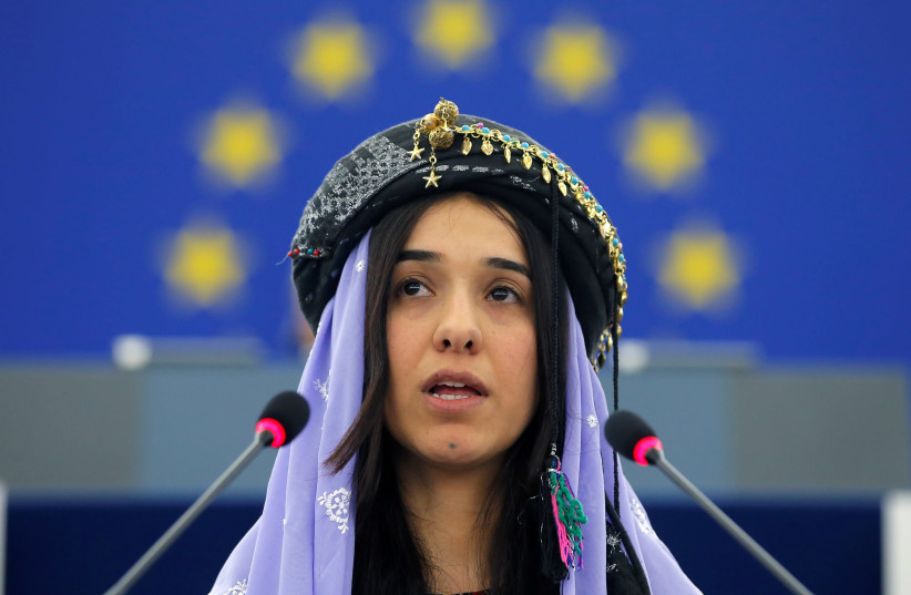 Nadia Murad Basee Taha adresses the European Parliament during an award ceremony for the 2016 Sakharov Prize at the European Parliament in Strasbourg, France, December 13, 2016 (photo credit: VINCENT KESSLER/ REUTERS)